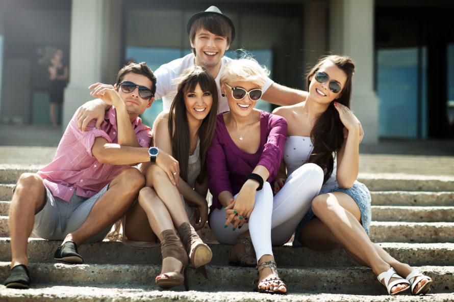 Group Of Friends Smiling Wearing Fun Colors