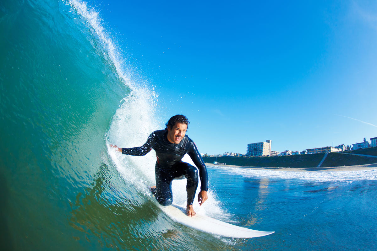 Surfer In Front Of Blue Sky Photograph