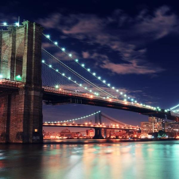 Long Bridge With Sparkling Lights and Speeding Traffic
