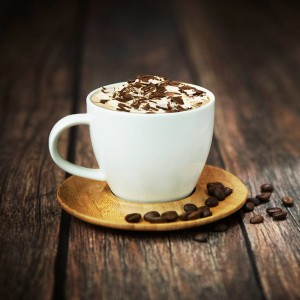 Coffee Cup With Chocolate and Coffee Beans