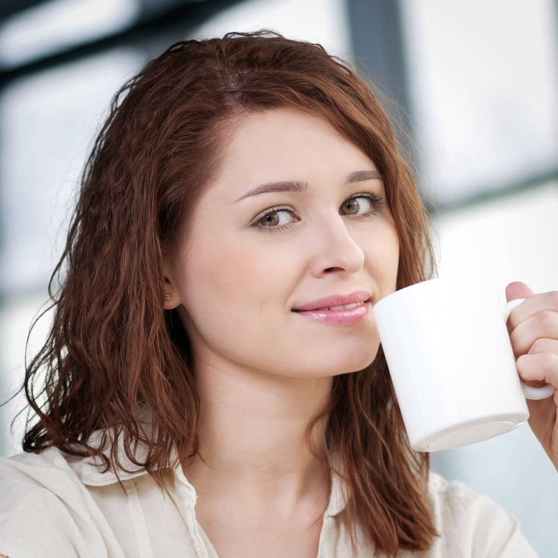 Person Smiling With Mug
